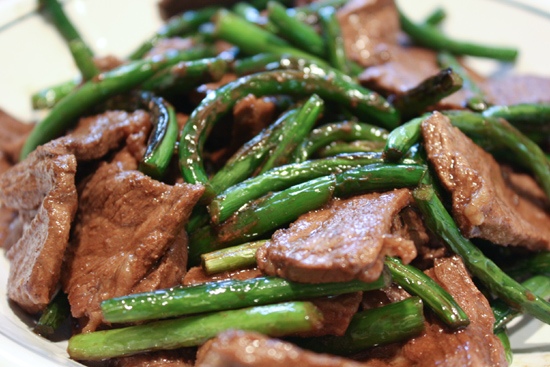 Garlic scapes and steak stir fry